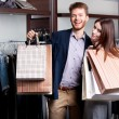 Laughing couple after shopping — Stock Photo