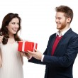Man gives present to his girlfriend — Stock Photo