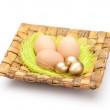 Royalty-Free Stock Photo: Easter eggs are on square wattled plate