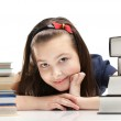 Pupil peeps out through the books — Stock Photo