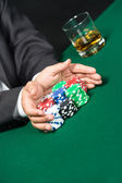 "Male player going ""all in"" pushing his poker chips forward — Stock Photo"