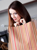 Woman is very pleased with bargains — Stock Photo