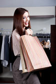 Carrying paper bags after successful purchase — Stock Photo