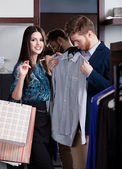 Woman recommends the shirt to her boyfriend — Stock Photo