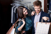 Attractive woman and young man are in the shop — Stok fotoğraf
