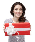 Young woman passes a present — Stock Photo