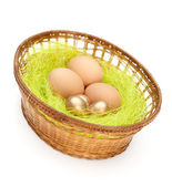 Easter eggs are in wattled basket — Stock Photo