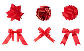 Collection of different red colored bows — Stock Photo