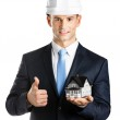 Engineer shows model house and thumbs up — Stock Photo #21260229