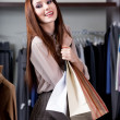 Holding paper bags — Stock Photo
