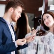 Couple is amazed with special prices - Stock Photo