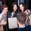 Women consult with shop assistant — Stock Photo