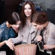 Girls wonder the purchases of their friend — Stock Photo