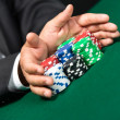 "Poker player stakes ""all in"" pushing his poker chips forward — Stockfoto"