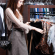 Looking for a perfect cloth which is in fashion — 图库照片