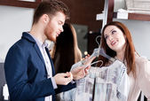 Couple is amazed with special prices — Stock Photo