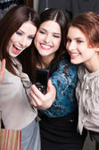 Girls take photo after shopping — Stock Photo