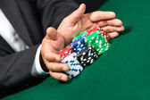 "Poker player stakes ""all in"" pushing his poker chips forward — Stock Photo"