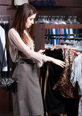 Looking for a perfect cloth which is in fashion — Stock Photo