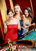 Three women playing roulette — Stock Photo