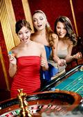 Three women playing roulette — Stock Photo