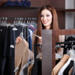 Girl is looking for a perfect cloth in the latest fashion — ストック写真