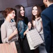 Girls consult with salesperson — Stock Photo