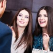 Two girls speak about discounts — Stock Photo