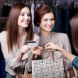 Friends pay with credit card — Stock Photo #22008867