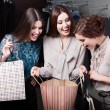 Girls wonder the purchases of their girlfriend — Stock Photo