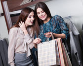 Two friends buy gifts with a rebate — Stock Photo