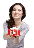 Young woman reaches out a present — Stock Photo