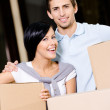 Happy couple carrying cardboard boxes — Stock Photo