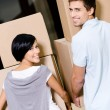 Back view of couple carrying cardboard boxes — Stock Photo