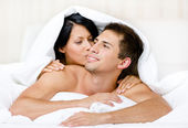 Close up view of couple playing in bedroom — Stock Photo