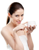 Woman putting on emollient cream on her nose — Stock Photo