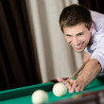 Постер, плакат: Man playing billiards at club