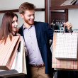 Royalty-Free Stock Photo: Couple with paper bags is in the shop