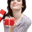 Young woman demonstrates a gift — Foto Stock