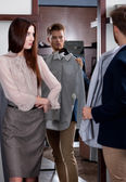 Advising with girlfriend while selecting a shirt — Stock Photo