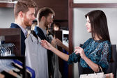 Consulting with girlfriend while selecting a fashionable shirt — Stockfoto