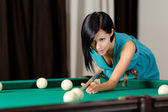 Young girl playing billiard — Stock Photo