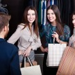 Girls consult with shop assistant — Stockfoto #22714521