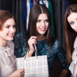 Three girls are in the store — ストック写真