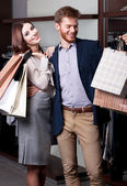 Couple is glad to go shopping — Stock Photo