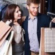 Pretty couple show their packets with gifts — Stock Photo