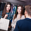 Stock Photo: Two girls speak to shop consultant