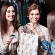 Stock Photo: Women pay charges account with credit card