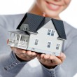 Close up of model house in female hands — Stock Photo