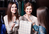 Women pay charges account with credit card — Stock Photo